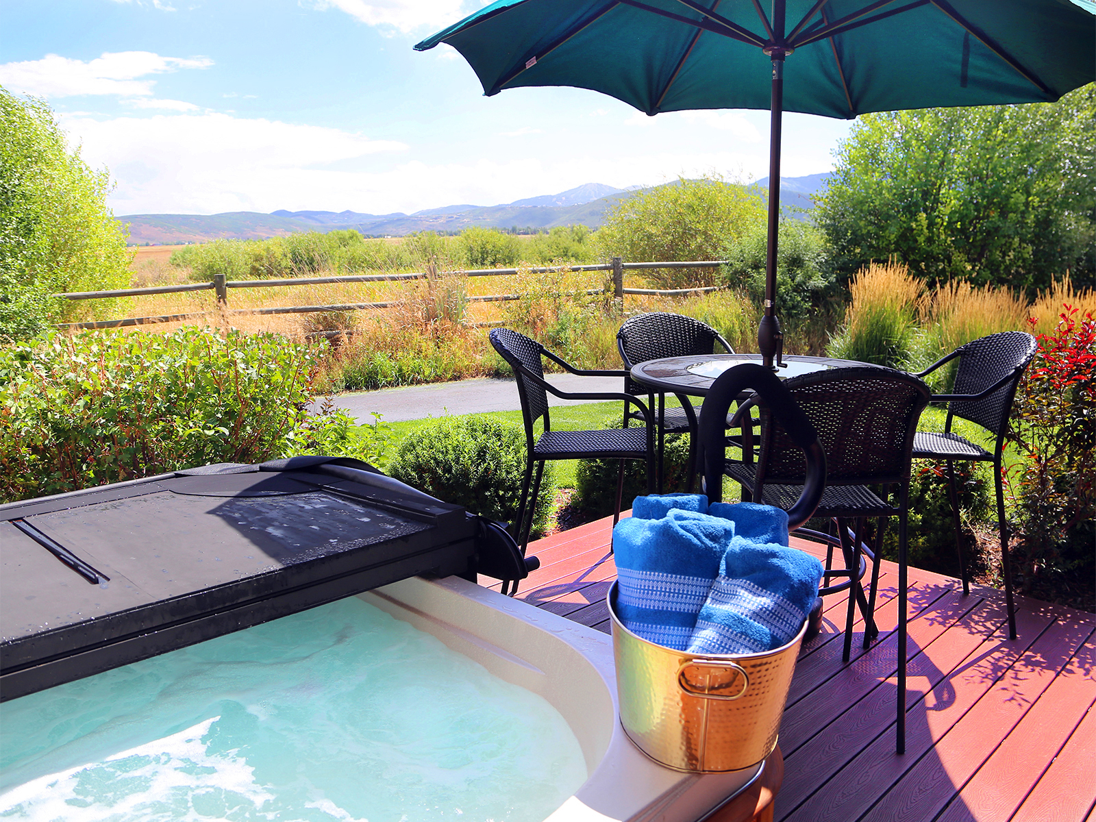 Newpark Townhome deck with hot tub overlooking the Swaner Nature Preserve
